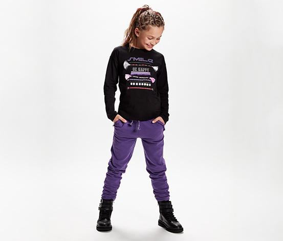 Dziewczęce fioletowe spodnie dresowe z ozdobną falbanką przy kieszeniach