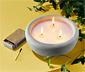 Świeczka o zapachu cytrynowym w cementowej miseczce